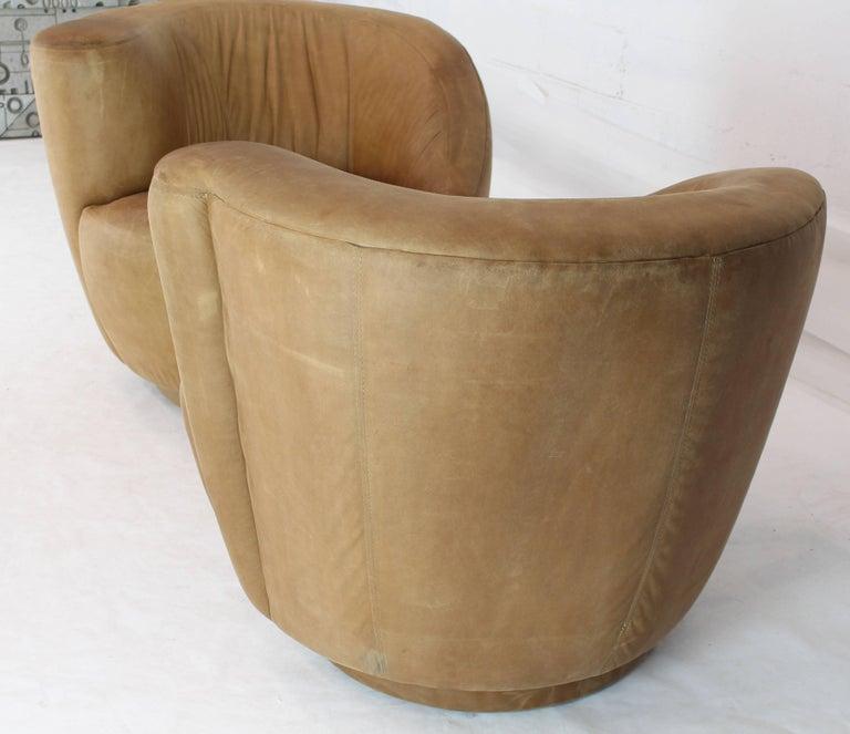 20th Century Pair of Vladimir Kagan Nautilus Tan Leather Swivel Lounge Chairs For Sale