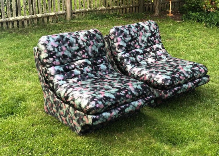 Iconic pair of matching 1980s preview lounge chairs and an exceptionally vibrant fabric. The upholstery is original and still shows well although there is some minor, age appropriate wear, as would be expected. The chairs are structurally sound with