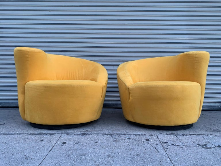 Vladimir Kagan designed Nautilus lounge chairs upholstered in a yellow microfiber fabric which matches the Vladimir Kagan Serpentine sofa we have listed (this was purchased as a set). Both, the chairs and sofa are designed by Vladimir Kagan and