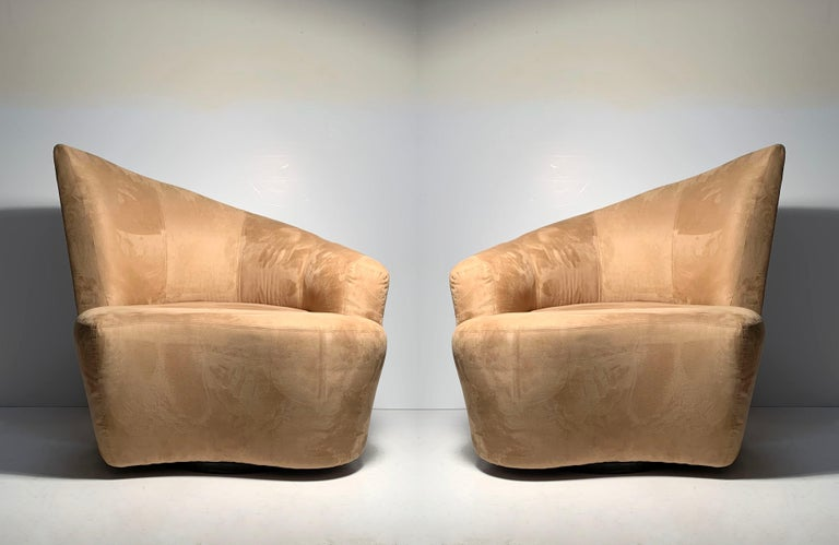 Pair of Vladimir Kagan Weiman Preview Bilbao swivel lounge chairs. Original fabric in a latte color. Some wear to the original fabric. Some areas on seat. I have not taken anywhere for cleaning, so those areas on seat may come out with a cleaning