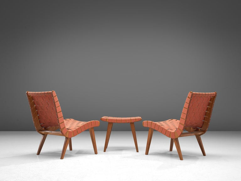 Jens Risom for Vostra/Walter Knoll, Pair of 'Vostra' chairs with ottoman, birch and canvas, United States, design 1941, production 1950s.  Elegant and simplistic slipper chairs with pouf that feature a beautiful curved seat. This line is truly