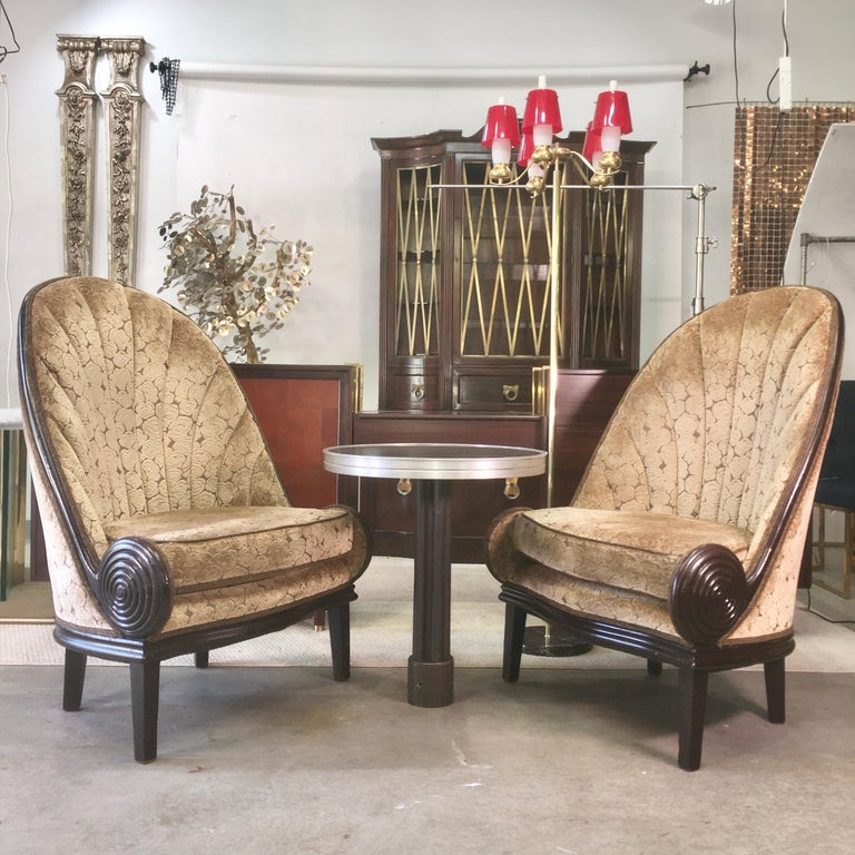 We are fortunate to have acquired two pair of these amazing gondola chairs from the glamorous and historic Waldorf Astoria Hotel. There were only a total of 12 of these generously scaled chairs upholstered in an art deco cut velvet and were situated