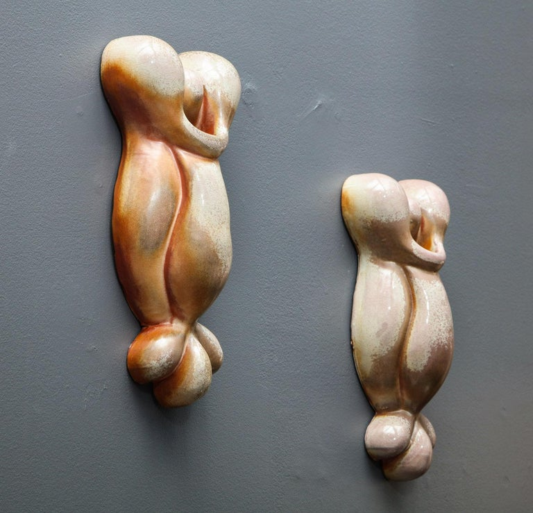 Pair of cast porcelain wall-mounted sculptures in warm and cool colored glaze. Wood fired. Artist-signed and dated on backside.