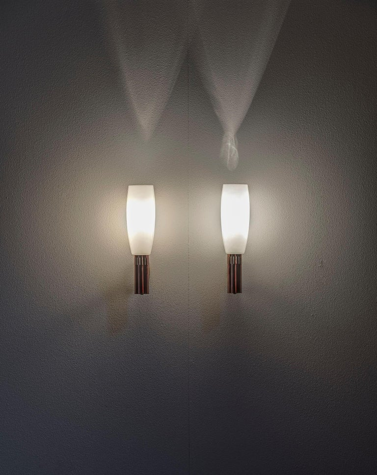 Huge pair of sconces by Stilnovo. Opaline glass with brass structure. Original label.