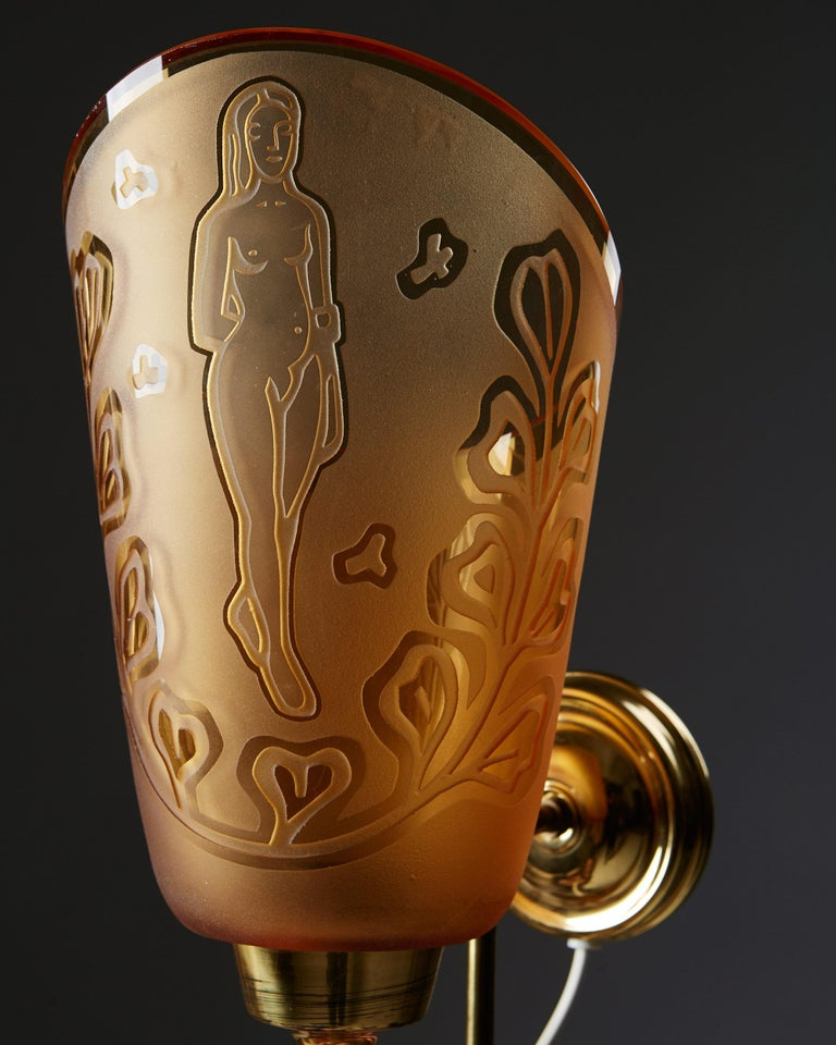 Engraved glass and brass.  Measures: H 41 cm/ 16