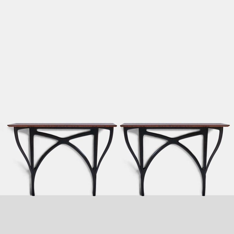 Pair of wall-mounted shelfs by Ico Parisi A pair of wall-mounted shelves by Ico Parisi for Arte casa, circa 1950. Made of Brazilian rosewood and ebonized walnut base. Italy, circa 1950 Sold and priced individually. Provenance: Authenticated by