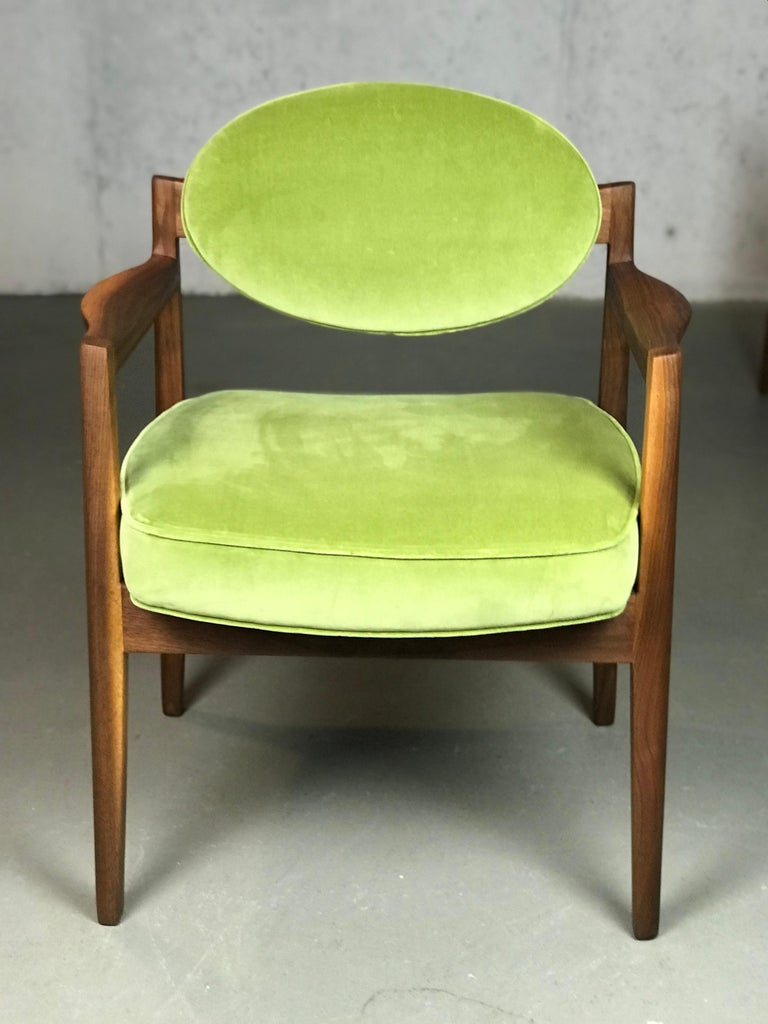 Beautiful set of Jens Risom designed armchairs, circa 1960s. The refinished walnut frames reveal beautiful walnut woods grains. Upholstered in sage green velvet. **Please look at the last photo to show the true color of the upholstery - the studio