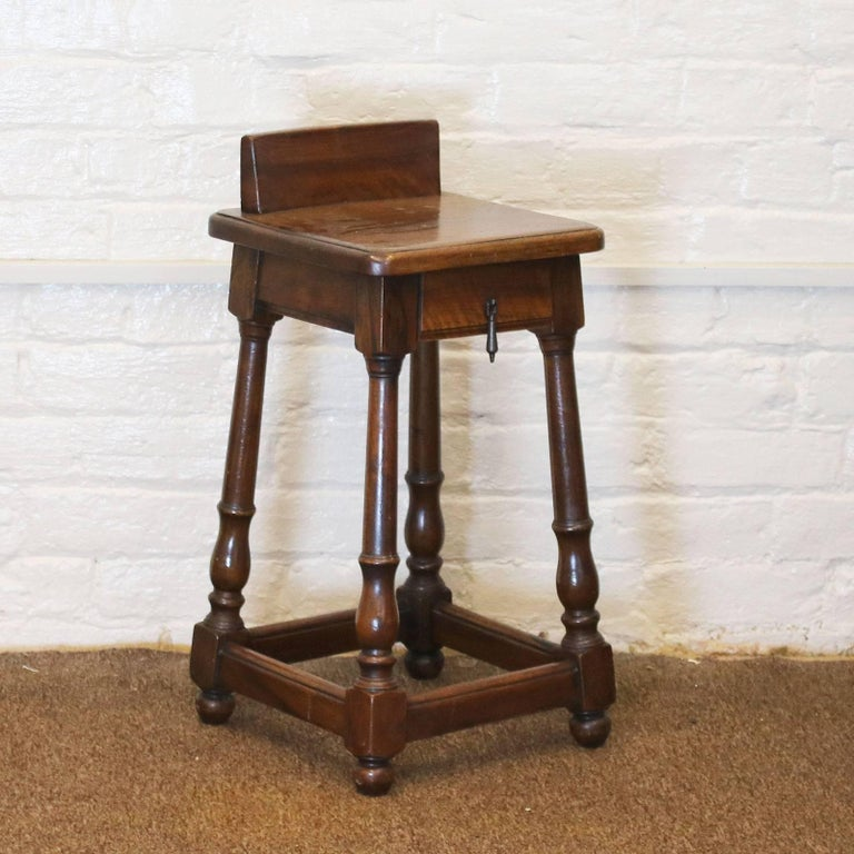 Matching pair of rustic style bedside tables in Walnut with a single working drawer.