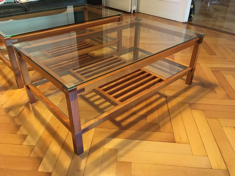 Walnut, brass corners and glass top coffee tables made by Pierre Vandel, Paris, circa 1980. Very good condition. Measures: 130 x 75 x 45 cm high. 2 available.