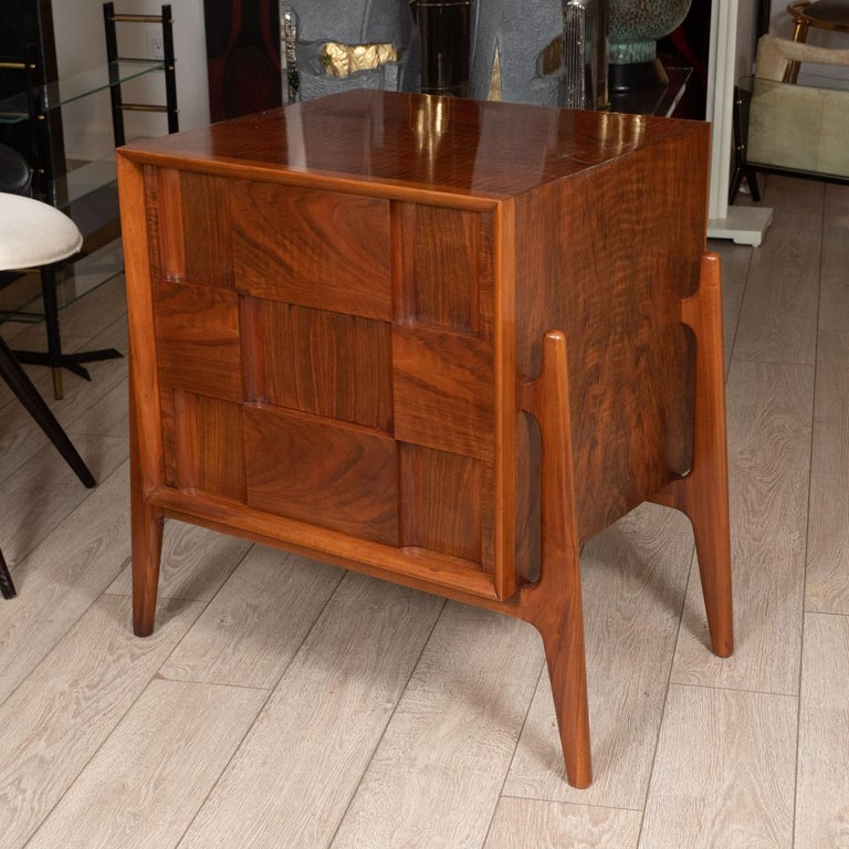 Pair of walnut checkered nightstands / side tables with drop-down front and single drawer by Edmond Spence.