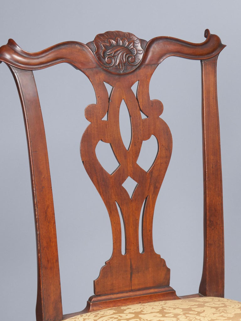 Carved caboshon shell on crest and cabriole legs with acanthus carved knees terminating in ball and claw feet. Philadelphia, PA, circa 1770.