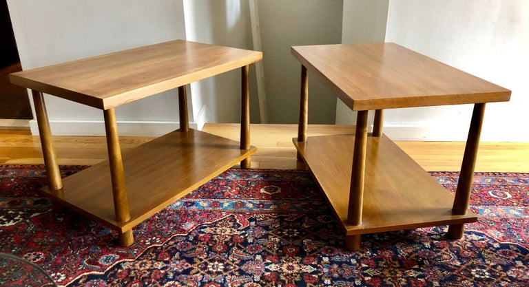 Classic Gibbings two-tier tables with inverse tapered dowel legs. Perfect proportions with through-dowel detail are an early expression of Gibbing's simplified modern elegance. With Widdicomb labels to underside.