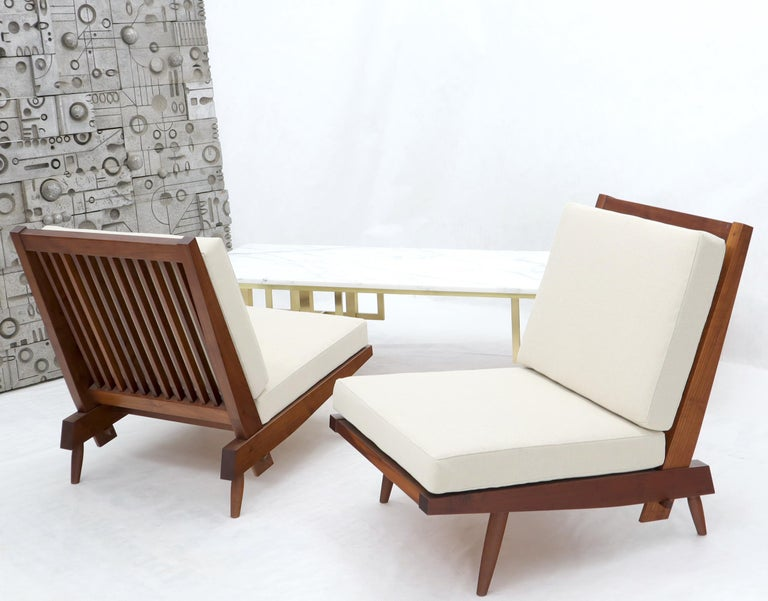 Oiled Pair of Walnut Lounge Chairs by George Nakashima For Sale