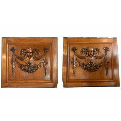 Pair of Walnut Panels with Carved Cherubs