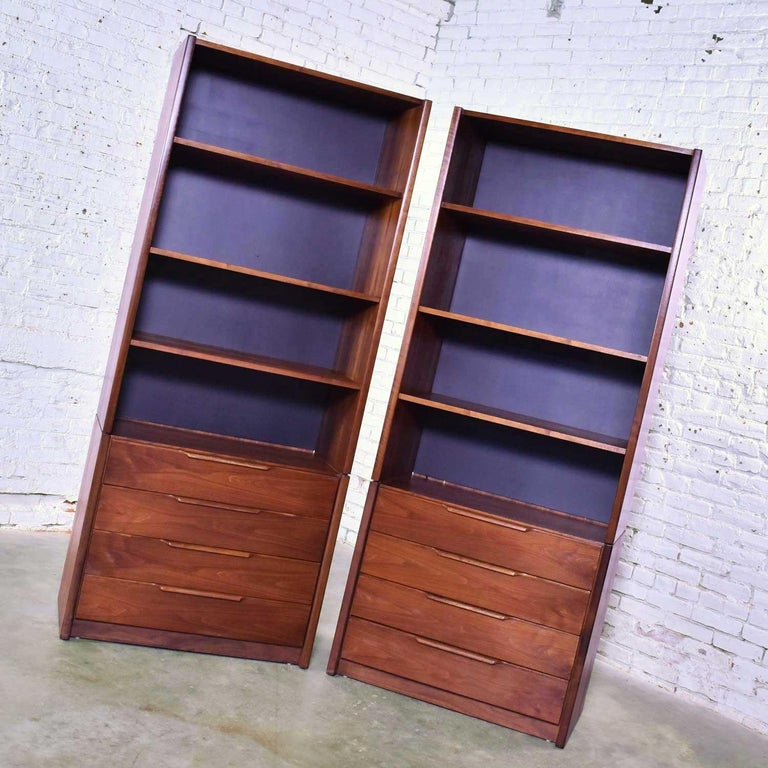 Handsome Scandinavian Modern style pair of tall walnut bookcase, display, and storage units by Barzilay Furniture Manufacturing Company. They are in fabulous vintage condition with no outstanding flaws we have found. Please see photos, circa