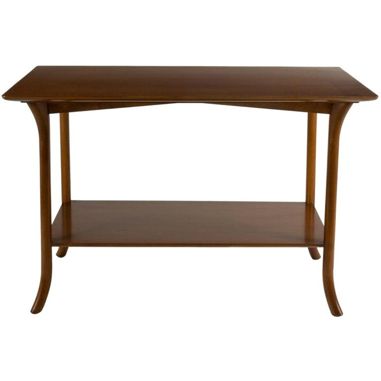 A pair of T.H. Robsjohn Gibbings for Widdicomb walnut side / end tables with cabriole legs and lower shelf. USA, circa 1950. Medium brown finish.