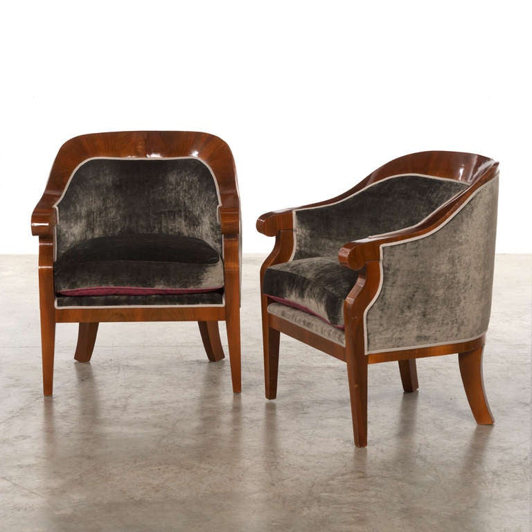 Pair of Art Deco armchairs, walnut veneered. Elegant and decorative. Reupholstered with grey velvet from zinc. Sold as a pair.