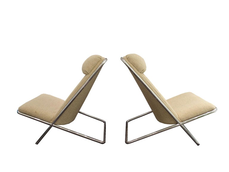 Pair of midcentury Ward Bennett scissor chairs with chevron upholstery and chrome frame, circa 1960s. Price is for the pair.