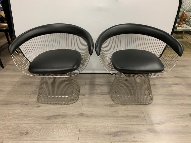 Black leather and steel pair of matching armchairs by Warren Platner for Knoll, circa 1960s. An absolutely incredible original Warren Platner, pair of polished steel arm chairs. These vintage armchairs have a magnificent look with black leather
