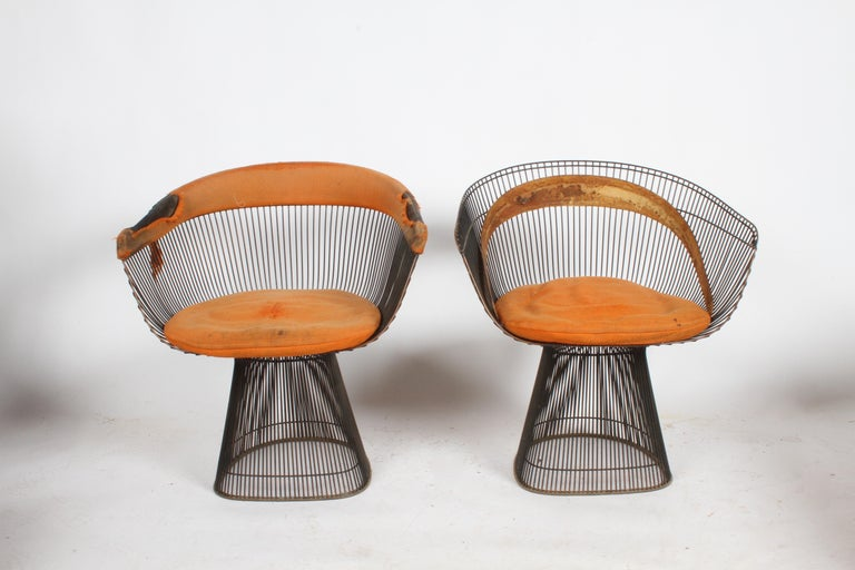 Pair of vintage Warren Platner for Knoll bronze dining chairs for Knoll, circa 1966. I sold the pair shown in the main photo, but now have two that are in need of re-upholstery. Original patina to bronze frames, one chair is missing the black rubber