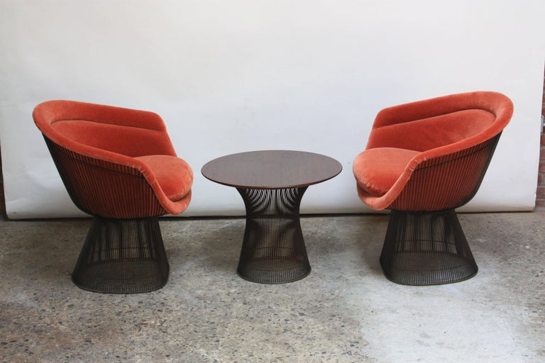 Suite of early (circa 1966) Warren Platner for Knoll Associates bronze-framed pieces: two wire lounge chairs redone in blood orange mohair and one wire-framed, walnut-top occasional table. Steel-rod construction with bronze-plate (a finish no longer