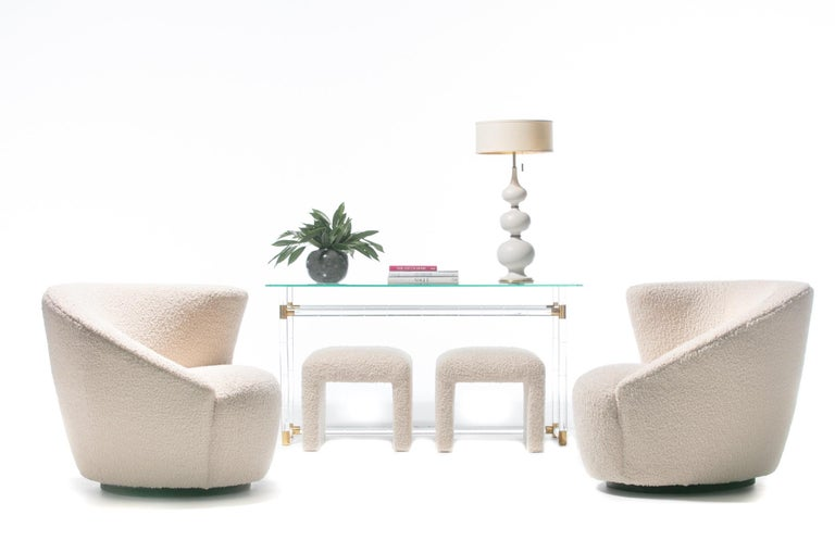 Sculptural and modern 1970s Directional waterfall benches professionally reupholstered in soft ivory bouclé fabric and photographed with a pair of Vladimir Kagan Nautilus swivel chairs - also by Directional - and a Charles Hollis Jones faux bamboo