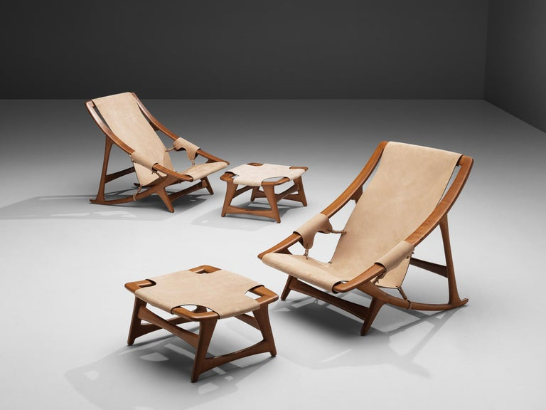 W.D. Andersag, pair lounge chairs with ottoman, teak, leather, Italy, 1960s  These chairs are very dynamic due its design and shapes. The teak frame shows beautiful lines. The frame and construction reminds of the sturdy hunting chairs. Thick