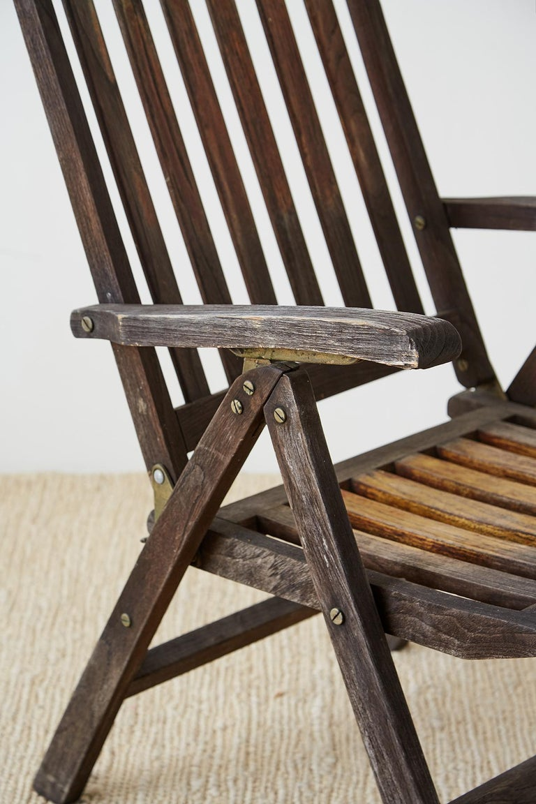 Pair of Weathered Vintage Teak Folding Chairs For Sale 8