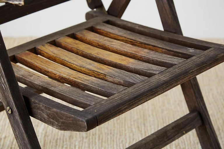Pair of Weathered Vintage Teak Folding Chairs For Sale 9