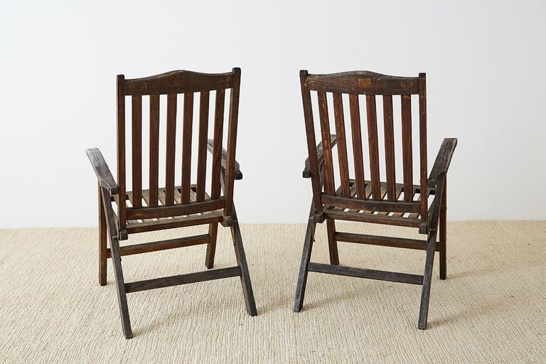 Pair of Weathered Vintage Teak Folding Chairs For Sale 11