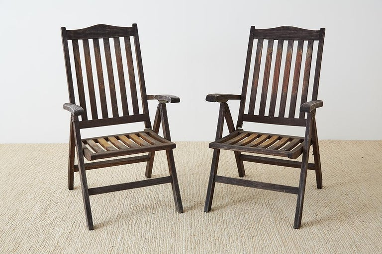 Mid-Century Modern Pair of Weathered Vintage Teak Folding Chairs For Sale
