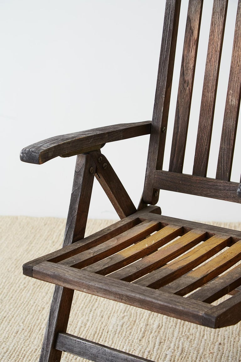 Pair of Weathered Vintage Teak Folding Chairs In Distressed Condition For Sale In Oakland, CA