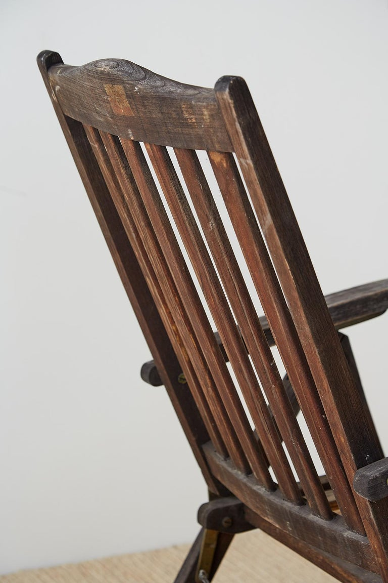 Brass Pair of Weathered Vintage Teak Folding Chairs For Sale