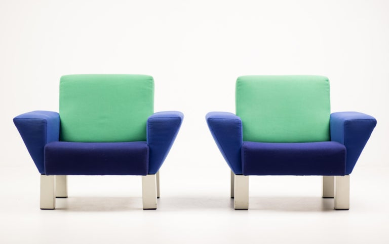 Iconic Ettore Sottsass 'Westside' chairs, blue and green wool upholstery, fabric lining marked 'KNOLL', designed 1983.