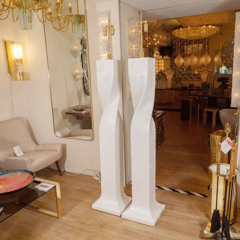 Pair of white composite plaster twisted floor lamps.