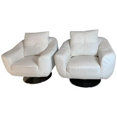 Pair of White Faux Leather Swivel Chairs