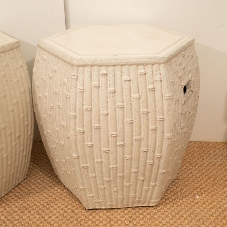 These ceramic garden stools, with their creamy white color, can mix with any color scheme, indoor or outdoor. Their hexagonal shape and bamboo motif make them a unique choice for a side table or seat. Priced individually at $650 each.