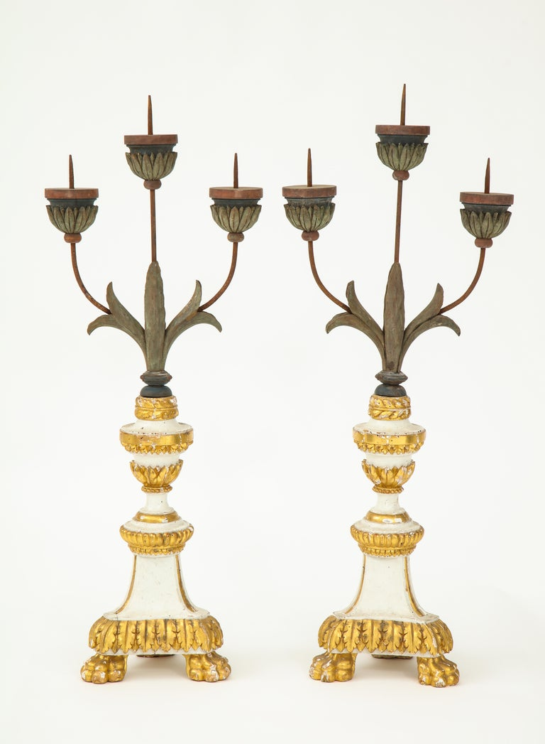 Fantastic and tall three armed hand carved candlesticks.