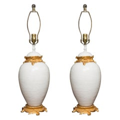 Pair of White Glazed Ceramic Lamps with Gilt Bronze Mounts