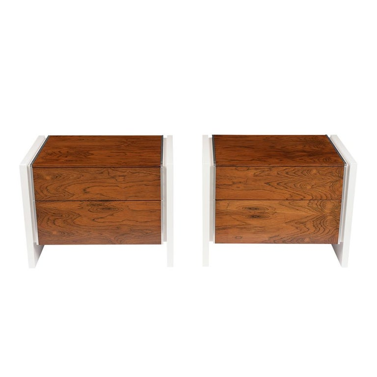 This Pair of Mid-Century Modern Glenn California Nightstands are made out of walnut and rosewood and have been completely restored. The set features a new white color lacquered finish, floating leg design, flat chrome molding details, and the top &