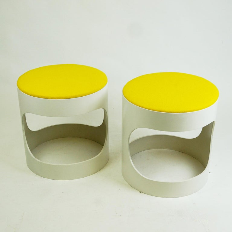 Charming white lacquered plywood circular stools. They are produced in Germany by Opal Kleinmöbel in the late 1960s and show the original manufacturers mark on the underside. The lacquer has been renewed and the seats are covered with a renewed