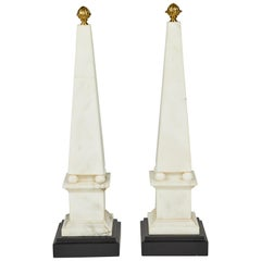 Pair of White Marble Obelisks on Painted Wood Bases with Brass Acorn Finials