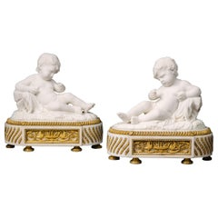 Pair of White Marble Sculptures of Reclining Putti