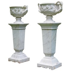 Pair of White Marble Urns on Tall White Marble Pedestals