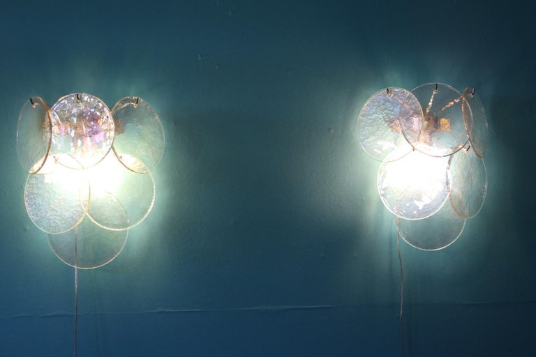 Exquisite pair of geometric structure holding iridescent and pearly Murano glass disks.Each glass disk has got magnificent blue,pink and green reflects 