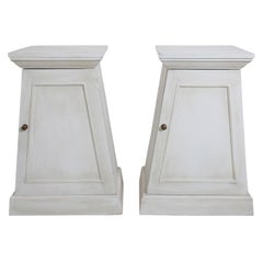Pair of White Painted Trapezoid Shaped Cabinets