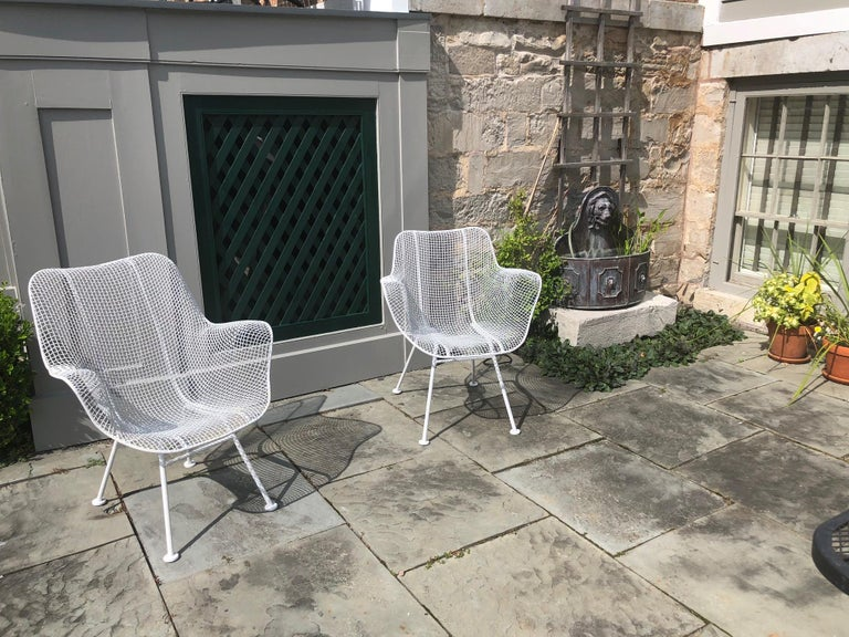 This stylish pair of Woodard patio chairs are from the