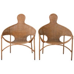 """Pair of Wicker and Iron """"People's"""" Chairs, U.S.A, 1960s"""