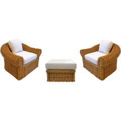 Pair of Wicker Lounge Chairs and Ottoman in the Style of Michael Taylor