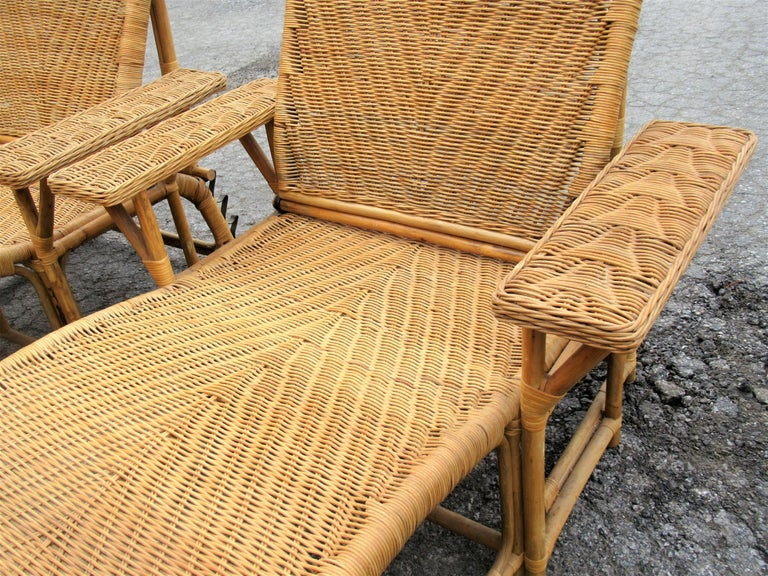 Pair Of Wicker Rattan Paddle Arm Reclining Chaise Lounges